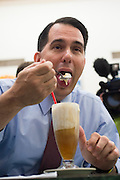 Republican presidential candidate Wisconsin Gov. Scott Walker eats an old fashioned vanilla ice cream soda while he visits with supporters at the Highland Park Soda Fountain in Dallas, Texas on September 2, 2015. (Cooper Neill for the Texas Tribune)