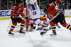 Feb 20, 2007; East Rutherford, NJ, USA; New York Rangers forward Sean Avery (16) is hit by New Jersey Devils defenseman Johnny Oduya (29) during the second period at Continental Airlines Arena in East Rutherford, NJ.
