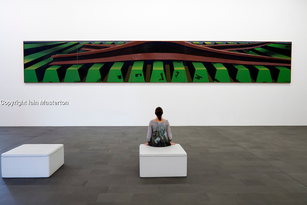 Woman looking at painting by Markus Lupertz at Kuppersmuhle Museum in Duisburg Germany