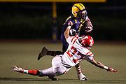 Milpitas' Savion Black (1) breaks a tackle by Saratoga's Ken Wu (27) during homecoming at Milpitas High School in Milpitas, California, on October 11, 2013.  Milpitas beat Saratoga 54-14. (Stan Olszewski/SOSKIphoto)