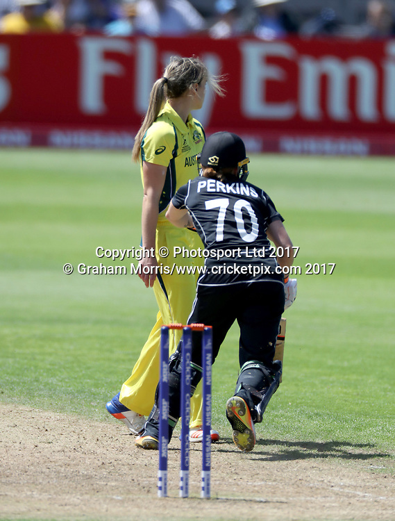 Katie Perkins runs around bowler Ellyse Perry before she is run out during the Women's World Cup fifty over match between Australia and New Zealand at the County Ground, Bristol. Photo: Graham Morris /www.photosport.nz