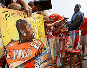 2007.07.30 BENGALS SPORTS : The Cincinnati Bengals Chad Johnson checks out some artwork by Anderson Twp. artist Tyler Hilderbrand after morning practice at training camp in Georgetown, Kentucky Monday July 30, 2007. The Enquirer/Jeff Swinger