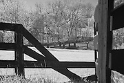 Rural Kentucky broken four plank fence showing bridge in the background.  Infrared (IR) photograph by fine art photographer Michael Kloth. Black and white infrared photographs