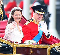 HRH Prince William and Miss Catherine Middleton tie the knot at Westminster Abbey returning to Buckingham Palace in open carriage. London, UK. 29/04/2011 <br />BYLINE MUST READ : GOTCHAIMAGES.COM<br /><br />Copyright by © Gotcha Images Ltd. All rights reserved.<br />Usage of this image is conditional upon the acceptance <br />of Gotcha Images Ltd, terms and conditions available at<br />www.gotchaimages.com