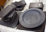 Photo shows suzuri ink stones and other slate items that were salvaged from the debris that are being cleaned and restored inside the makeshift craftsmens' workshop in Ogatsu, Ishinomaki City, Japan on 9 Sept. 2012.  Photographer: Robert Gilhooly
