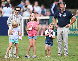 Mia Tindall helps Princess Anne give out rosettes for the RDA on the third day of The Magic Millions Festival of British Eventing at Gatcombe Park, Minchinhampton, Gloucestershire, UK, on the 4th August 2019. 04 Aug 2019 Pictured: Savannah Phillips, Isla Phillips and Mia Tindall help Princess Anne give out rosettes on the third day of The Magic Millions Festival of British Eventing at Gatcombe Park, Minchinhampton, Gloucestershire, UK, on the 4th August 2019. Photo credit: James Whatling / MEGA TheMegaAgency.com +1 888 505 6342