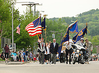 NH American Legion National Executive Commander Earl Beale and VFW Commander Bill North lead the Memorial Day parade down Main Street to Veteran's Square on Monday morning.  (Karen Bobotas/for the Laconia Daily Sun)