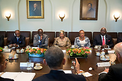 President Barack Obama and Vice President Joe Biden hold a multilateral meeting with West African leaders regarding Ebola, in the Cabinet Room of the White House, April 15, 2015. Seated across from the President, from left, are President Alpha Conde of Guinea; Amara Konneh, Minister of Finance, Liberia; President Ellen Johnson Sirleaf of Liberia; Julia Duncan Cassell, Minister of Gender and Development, Liberia and President Ernest Bai Koroma of Sierra Leone. (Official White House Photo by Pete Souza)<br /> <br /> This official White House photograph is being made available only for publication by news organizations and/or for personal use printing by the subject(s) of the photograph. The photograph may not be manipulated in any way and may not be used in commercial or political materials, advertisements, emails, products, promotions that in any way suggests approval or endorsement of the President, the First Family, or the White House.