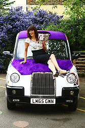 EDITORIAL USE ONLY<br /> Author Liz Pichon at the launch of Scholastic&Otilde;s '100 Books for 100 Schools' giveaway with a Tom Gates themed taxi to celebrate the publication of her new book, Tom Gates: Family, Friends and Furry Creatures, at Drayton Green Primary School in Ealing, London.