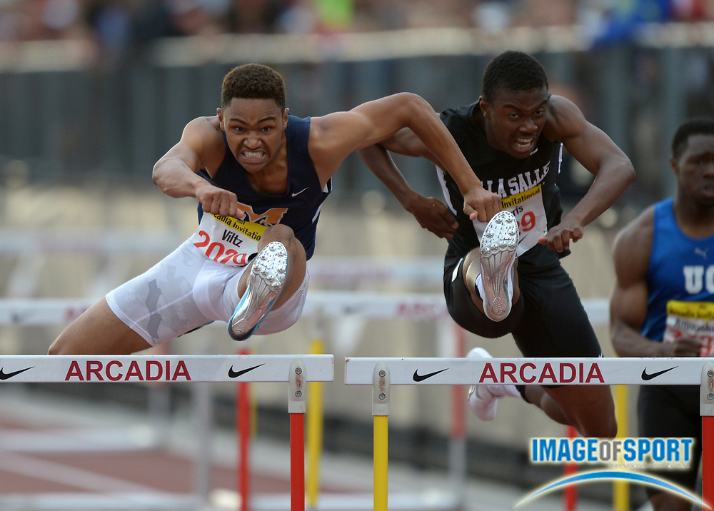 Apr 12, 2014; Arcadia, CA, USA; Misana Viltz of Long Beach Millikan (left) defeats Marquis Morris of Concord De La Salle to win the 110m hurdles in the 47th Arcadia Invitational at Arcadia High. Viltz and Morris were both timed in 13.93.