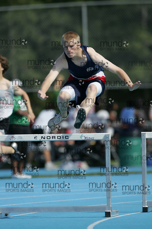 MacKenzie Moseley competing in the junior boys 300m hurdles heat at the 2007 OFSAA Ontario High School Track and Field Championships in Ottawa.