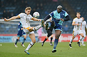 Wycombe Wanderers Adebayo Akinfenwa(20) clashes with Port Vale's Nathan Smith(24) during the EFL Sky Bet League 2 match between Wycombe Wanderers and Port Vale at Adams Park, High Wycombe, England on 24 March 2018. Picture by Alistair Wilson.