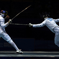 Patrik Esztergal (R) of Hungary fight with Flygare Islas (L) of Sweden during  the Fencing Men's Epee Individual final at International Expo Centre of the Nanjing 2014 Youth Olympic Games in Nanjing, China 18 August 2014. The Nanjing Youth Olympic Games 2014 runs from from 16 to 28 August 2014.