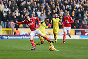 Oxford United stiker Rob Hall (19) and Swindon Towns James Brophy battle for the ball during the EFL Sky Bet League 1 match between Swindon Town and Oxford United at the County Ground, Swindon, England on 5 February 2017. Photo by Shane Healey.