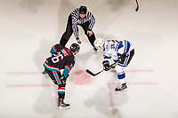 KELOWNA, CANADA - NOVEMBER 23:  Liam Kindree #26 of the Kelowna Rockets faces off against Dino Kambeitz #25 of the Victoria Royals on November 23, 2018 at Prospera Place in Kelowna, British Columbia, Canada.  (Photo by Marissa Baecker/Shoot the Breeze)