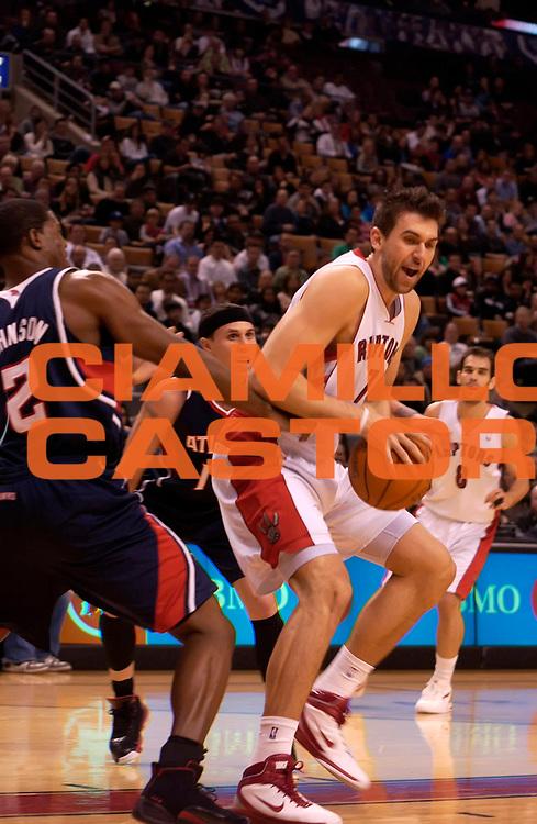 DESCRIZIONE : Toronto NBA 2010-2011 Toronto Raptors Atlanta Hawks<br /> GIOCATORE : Andrea Bargnani<br /> SQUADRA : Toronto Raptors Atlanta Hawks<br /> EVENTO : Campionato NBA 2010-2011<br /> GARA : Toronto Raptors Atlanta Hawks<br /> DATA : 28/11/2010<br /> CATEGORIA :<br /> SPORT : Pallacanestro <br /> AUTORE : Agenzia Ciamillo-Castoria/V.Keslassy<br /> Galleria : NBA 2010-2011<br /> Fotonotizia : Toronto NBA 2010-2011 Toronto Raptors Atlanta Hawks<br /> Predefinita :