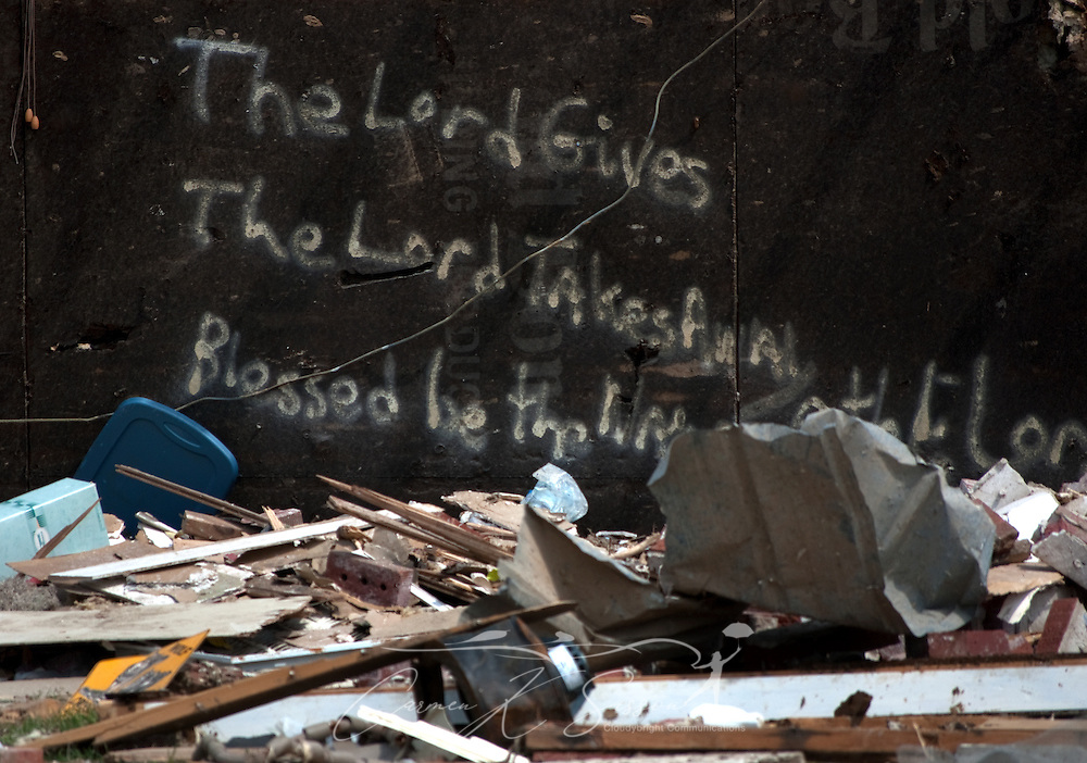 Words scrawled on the side of a damaged house greet passersby with a message of faith on May 1, 2011 in Smithville, Miss. Sixteen people died in the town during the April 27, 2011 EF5 tornado, part of a storm system that swept across six states in the South, killing 342 people and injuring thousands. (Photo by Carmen K. Sisson/Cloudybright)