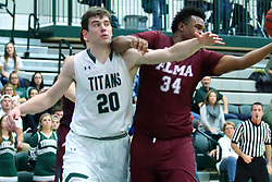 17 November 2017:  Kevin Gamble gets his elbow to the chin of Alex O'Neill during an College men's division 3 CCIW basketball game between the Alma Scots and the Illinois Wesleyan Titans in Shirk Center, Bloomington IL