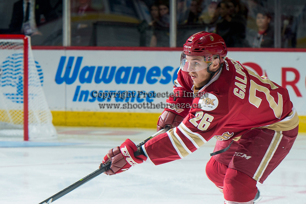 REGINA, SK - MAY 19: Olivier Galipeau #26 of Acadie-Bathurst Titan passes the puck against the Swift Current Broncos at the Brandt Centre on May 19, 2018 in Regina, Canada. (Photo by Marissa Baecker/CHL Images)