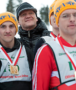 (C) Polish famous actor Cezary Pazura poses athete with intellectual disabilities while sport competition during VIII Polish Winter Games Special Olympics at Wisla on February 26, 2012...Poland, Wisla, February 26, 2012..Picture also available in RAW (NEF) or TIFF format on special request...For editorial use only. Any commercial or promotional use requires permission...Photo by © Adam Nurkiewicz / Mediasport