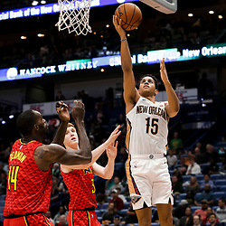 Mar 26, 2019; New Orleans, LA, USA; New Orleans Pelicans guard Frank Jackson (15) shoots over Atlanta Hawks center Dewayne Dedmon (14) and guard Kevin Huerter (3) during the second half at the Smoothie King Center. Mandatory Credit: Derick E. Hingle-USA TODAY Sports