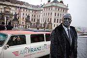 "Portrait of Prof. Vladimír Franz in front of Prague Castle and the ""Air Franz One"" - his official campaign car - on his way from the Prague National Opera to a discussion with all Czech presidential candidates at the National Technical Library in Prague Dejvice. Franz is a prominent Czech composer and painter, stage music author and also a registered candidate in the 2013 Czech presidential election."