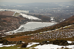 © Licensed to London News Pictures. 10/02/2012. Derbyshire, UK. Viewed from the Peak District hills above, the Hurst Resevoir, in Glossop, Derbyshire, has frozen over in sub-zero termparates. Photo credit : Joel Goodman/LNP