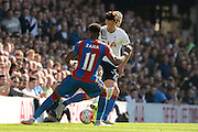 Son Heung-Min watched by Wilfried Zaha during the Barclays Premier League match between Tottenham Hotspur and Crystal Palace at White Hart Lane, London, England on 20 September 2015. Photo by Alan Franklin.