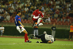 BELGRADE, SERBIA & MONTENEGRO - Wednesday, August 20, 2003: Wales' Nathan Blake skips over Serbia & Montenegro's goalkeeper Dragoslav Jervic during the UEFA European Championship qualifying match at the Red Star Stadium. (Pic by David Rawcliffe/Propaganda)