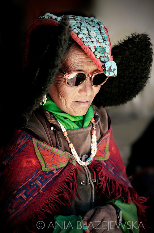 India, Ladakh. Woman attending a festival in Korzok monastery wearing a beautiful headdress.