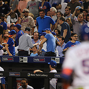 NEW YORK, NEW YORK - June 16: Fans react as a man sitting between children on the front row above the Mets dugout is hit by a hard driven foul ball by Yoenis Cespedes #52 of the New York Mets during the Pittsburgh Pirates Vs New York Mets regular season MLB game at Citi Field on June 16, 2016 in New York City. (Photo by Tim Clayton/Corbis via Getty Images)