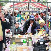 NLD/Amsterdam/20130701 - Keti Koti Ontbijt 2013 op het Leidse Plein, Rijk Groenink in zn kraam aan het eten