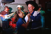 05 AUGUST 2000 - WILLIAMS, AZ: People at the rodeo dance at the 22nd Annual Cowpunchers' Reunion Rodeo in Williams, Arizona, Aug 5.  The Cowpunchers' Reunion Rodeo is held for working cowboys from the ranches in Arizona and the region. PHOTO BY JACK KURTZ