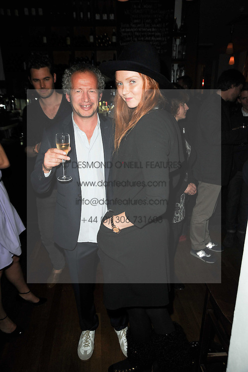 CARL FREEDMAN and LILY COLE at a party to celebrate the 10th anniversary of Counter Editions the contemporary art website held at Rivington Grill, Shoreditch, London on 5th May 2010.