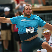WHITING - 13USA, Des Moines, Ia.  - Ryan Whiting watches his winning throw in the shot put.   Photo by David Peterson