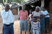 Shirhami Shrinda Legal Researcher from the LRC meets with Mother &amp; Daughter Francina and Selina Netshakhuma. They have lived and worked on a farm near Musina for several years. When the farm was sold the new owner no longer required their services and threatened them with eviction without giving them an alternative place to go. The Legal Resources Centre has assisted them with legal advice and prevented them from becoming homeless. This case illustrates the vulnerability of rural farm workers who have no security of tenure. Near Musina, Limpopo, South Africa.<br /> <br /> Photograph by Zute Lightfoot