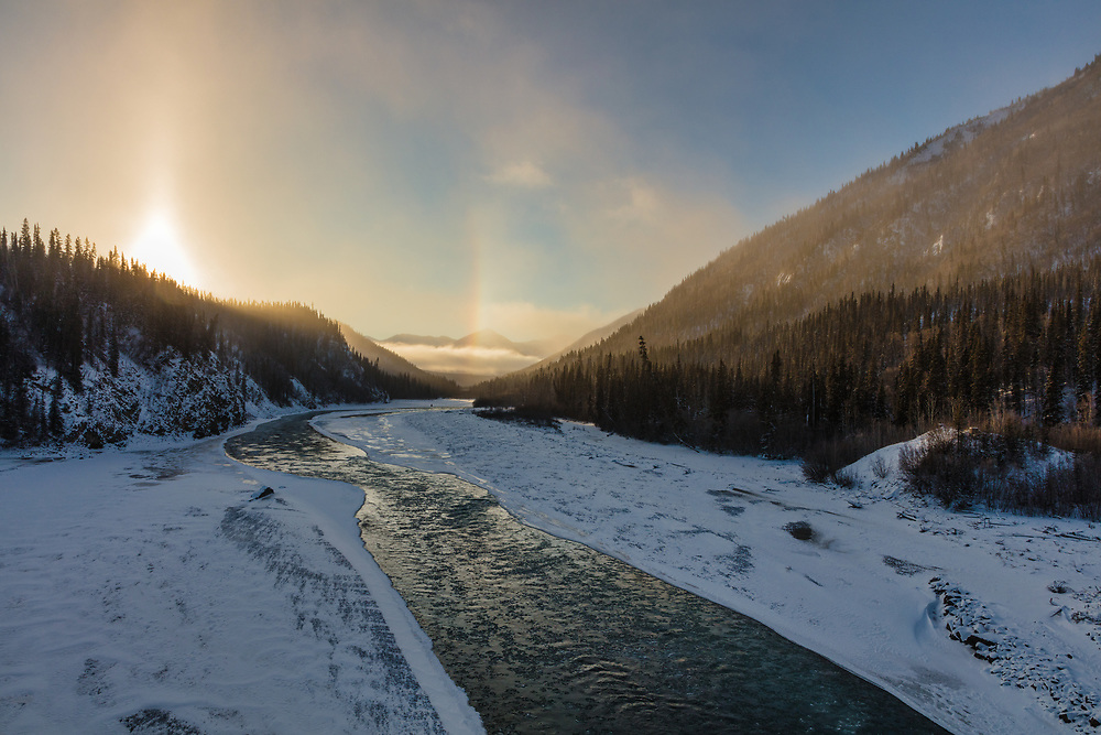 Icebow over the White River created by blowing snow in the Yukon Territory. Winter. Morning.