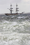 "Windjammer ""Astrid"" of Adler-Schiffe braving the waves of the North Sea while passing the Southern tip of Sylt, the Hörnum Odde."