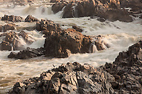 Morning light spreads across the rocks at Great Falls near Washington DC.