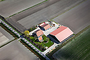 Nederland, Noord-Holland, Gemeente Waterland, 16-04-2012; Oosterweg, polder De Purmer. Boerenbedrijf, boerderij met woonhuis en schuren.A farmhouse with barns and stables in the polder The Purmer. .luchtfoto (toeslag), aerial photo (additional fee required);.copyright foto/photo Siebe Swart
