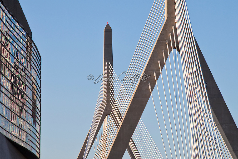 Detail of the Leonard P. Zakim Bunker Hill Bridge, the widest cable-stayed bridge in the world and the TD Garden facade left, Boston Massachusetts