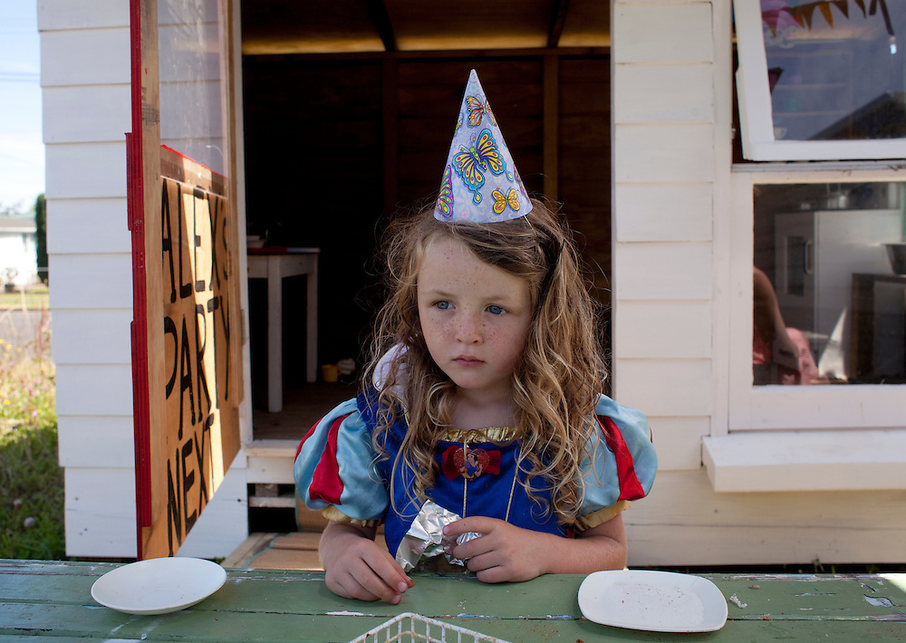 Alex having a tea party in her new cubby house, New Zealand, 2011.