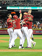 Apr. 17 2011; Phoenix, AZ, USA; Arizona Diamondbacks batter Stephen Drew (6) celebrates with teammates after hitting the game winning  single during the twelfth inning against the San Francisco Giants at Chase Field. The Diamondbacks defeated the Giants in extra innings 6-5. Mandatory Credit: Jennifer Stewart-US PRESSWIRE.