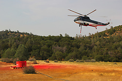 July 30, 2018 - California, U.S. - Fire helicopter grabs more fire retardant. The Ferguson Fire now in its 20th day, started July 13 on the Sierra National Forest. The fire is now 62,883 acres with 39 percent containment and 3,558 personnel that are currently engaged on the fire which include 203 engines, 43 water tenders, 14 helicopters, 95 crews, 5 masticators and 62 dozers. There has been 2 fatalities and 9 injuries to date. 1 structure has been destroyed. (Credit Image: © Rubicon/Cal Fire via ZUMA Wire/ZUMAPRESS.com) (Credit Image: © Rubicon/Cal Fire via ZUMA Wire/ZUMAPRESS.com)