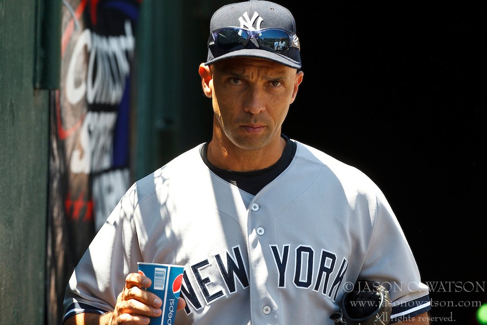 OAKLAND, CA - JULY 22: Raul Ibanez #27 of the New York Yankees enters the dugout before the game against the Oakland Athletics at O.co Coliseum on July 22, 2012 in Oakland, California.  The Oakland Athletics defeated the New York Yankees 5-4 in 12 innings. (Photo by Jason O. Watson/Getty Images) *** Local Caption *** Raul Ibanez