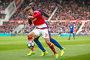 Middlesbrough midfielder Gaston Ramirez (21) gets away from Manchester United defender Eric Bailly (3) during the Premier League match between Middlesbrough and Manchester United at the Riverside Stadium, Middlesbrough, England on 19 March 2017. Photo by Simon Davies.