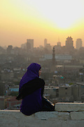 Woman taking in the sunset overlooking  Cairo.