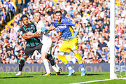 Leeds United goalkeeper Francisco Casilla (13) holds off Swansea City midfielder Wayne Routledge (15) and Leeds United midfielder Adam Forshaw (4) during the EFL Sky Bet Championship match between Leeds United and Swansea City at Elland Road, Leeds, England on 31 August 2019.