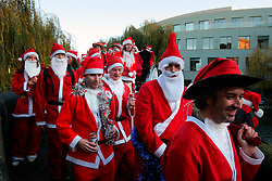 UK ENGLAND LONDON 16DEC06 - Revellers dressed as Santa Claus gather at Camden Lock for the annual Santacon outing. Every December for the last 13 years, Cacophonous Santas have been visiting cities around the world, engaging in a bit of Santarchy as part of the annual Santacon events. . . It all started back in 1994 when several dozen Cheap Suit Santas paid a visit to downtown San Francisco for a night of Kringle Kaos. Things have reached Critical Xmas and Santarchy is now a global phenomenon.. . jre/Photo by Jiri Rezac. . © Jiri Rezac 2006. . Contact: +44 (0) 7050 110 417. Mobile:  +44 (0) 7801 337 683. Office:  +44 (0) 20 8968 9635. . Email:   jiri@jirirezac.com. Web:    www.jirirezac.com. . © All images Jiri Rezac 2006 - All rights reserved.