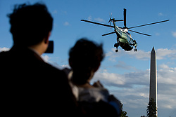 White House guests look on and take photos as Marine One, carrying United States President Donald J. Trump, departs the South Lawn of the White House on October 07, 2017. The President will travel to Greensboro, North Carolina this evening to participate in a roundtable discussion with Republican National Committee members before returning to Washington, D.C. tonight.